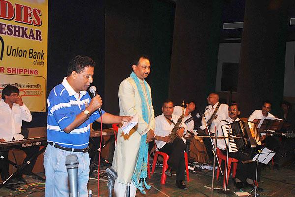 Binu Nair Inviting Chief Guest Pascal Pinto